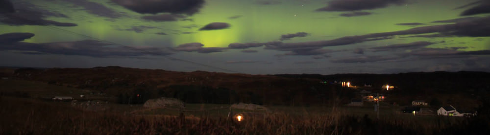 Dark sky shows the Aurora Borealis on Isle of Sky