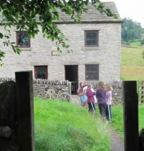 The kids exploring the garden of the Reckoning House in the Derbyshire Dales