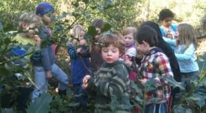 Children enjoy the wood at Shining Cliff Hostel