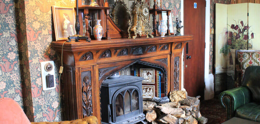 Fireplace in the bar at Adelina Patti's Craig Y Nos Castle