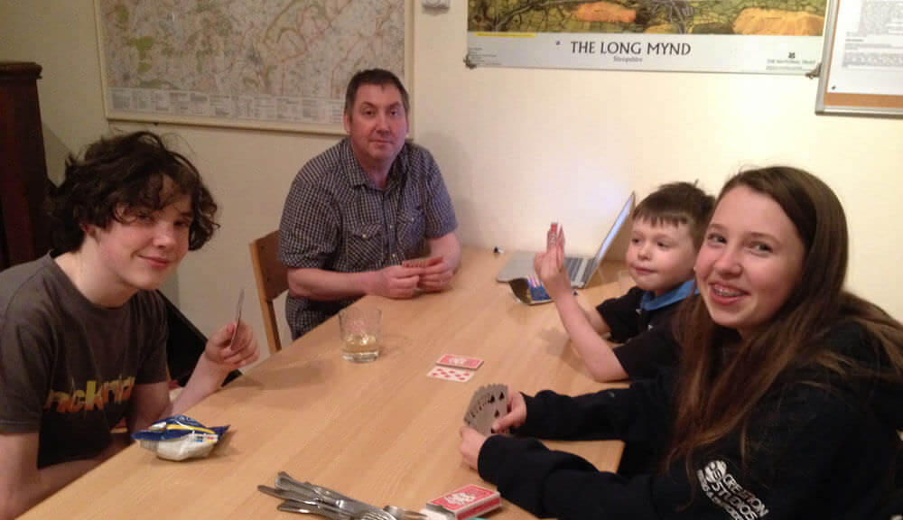 Playing cards at All Stretton Bunkhouse in Shropshire