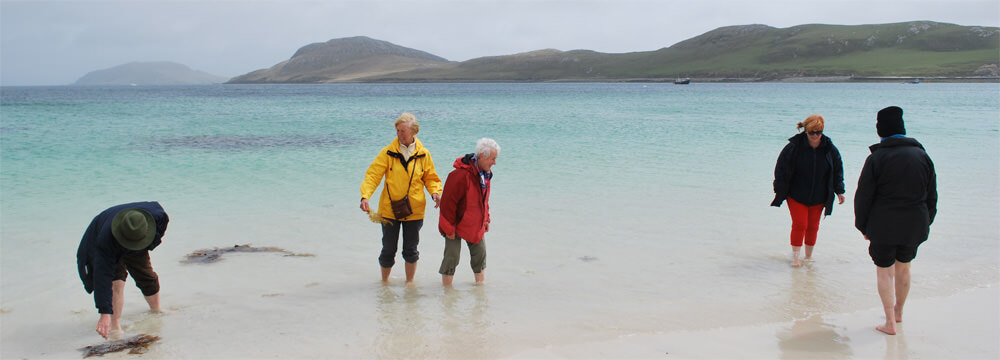 Never mind the weather paddle in the sea on Vatersay