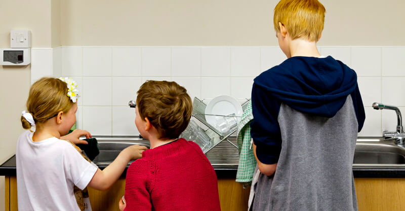 Self catering children, washing up at Alnwick Hostel
