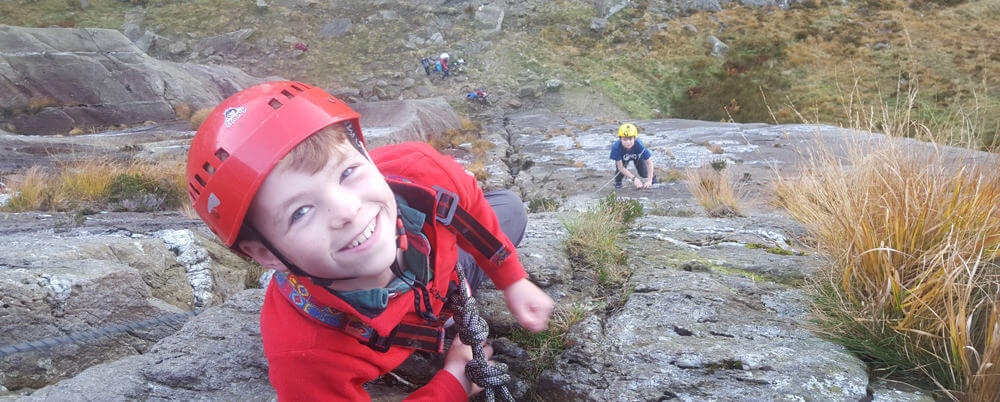 Climbing the slabs by the lake on Tryfan in Snowdonia