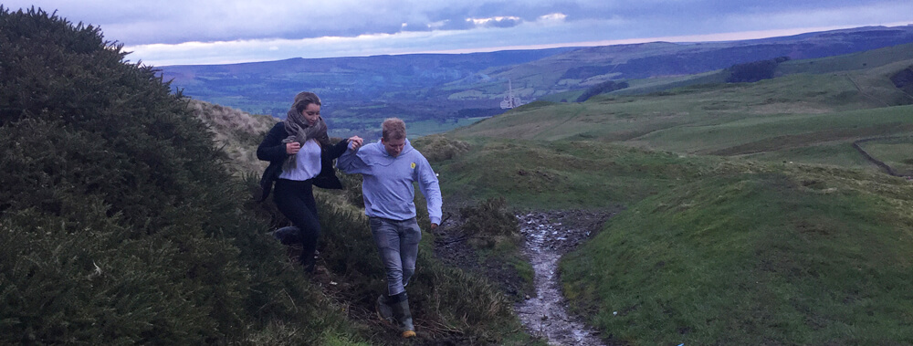 Helping each other out at Mam Tor