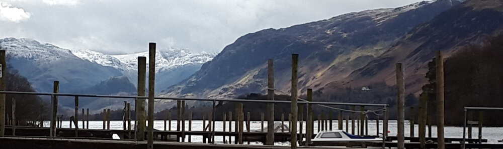 Snow on the mountains viewed from the Keswick Launch Peir