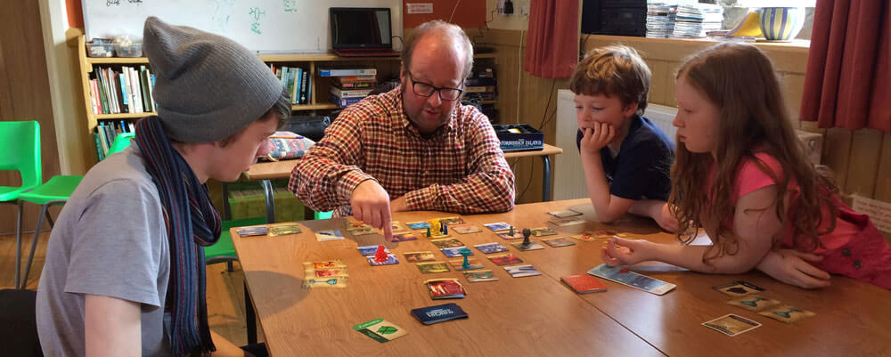 Playing board games at Hardraw Old School Bunkhouse, great accommodation for a group of families.