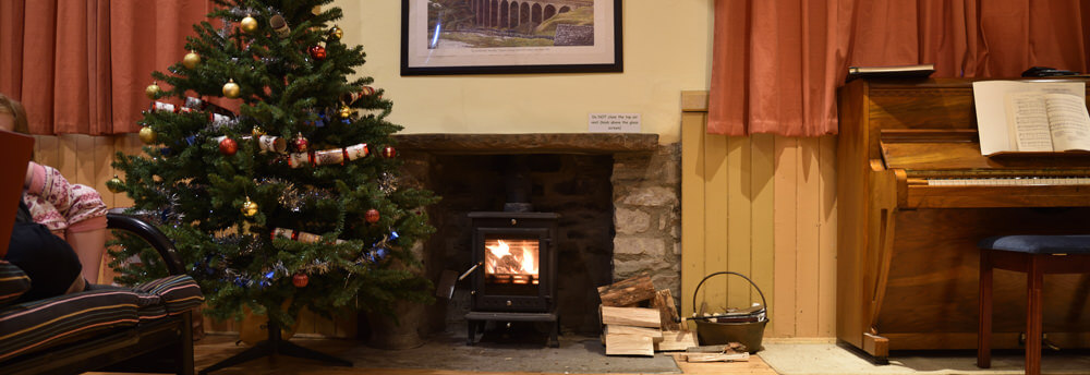 A cosy hostel sitting room with accommodation for the whole family at Christmas.