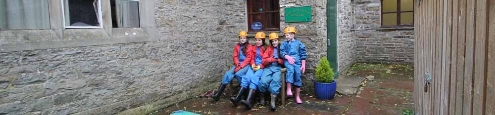 Togged up for Yorkshire Dales caving at Hardraw Old School