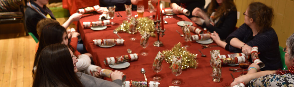 A large family Christmas around a bunkhouse table