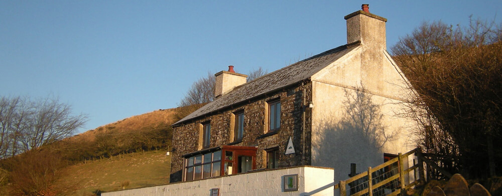 Here's Ty'n Cornel Hostel in 2017,  newly stripped of the YHA sign ( you can just see the shadow it has left on the stonework)