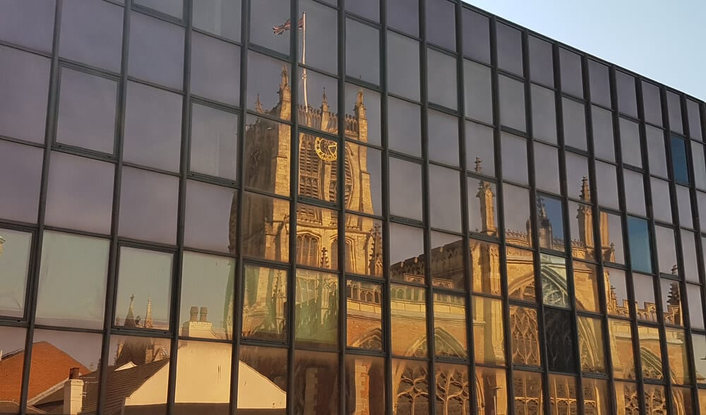 View from Trinity Hull Backpackers showing Holy Trinity Church reflected in the building oposite