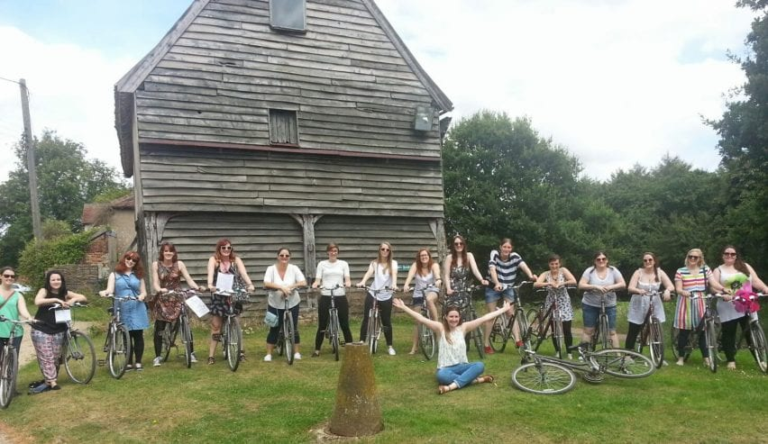 Cyclists at historic Tudor Barn Hostel at Milden Hall, nr Lavenham, Suffolk