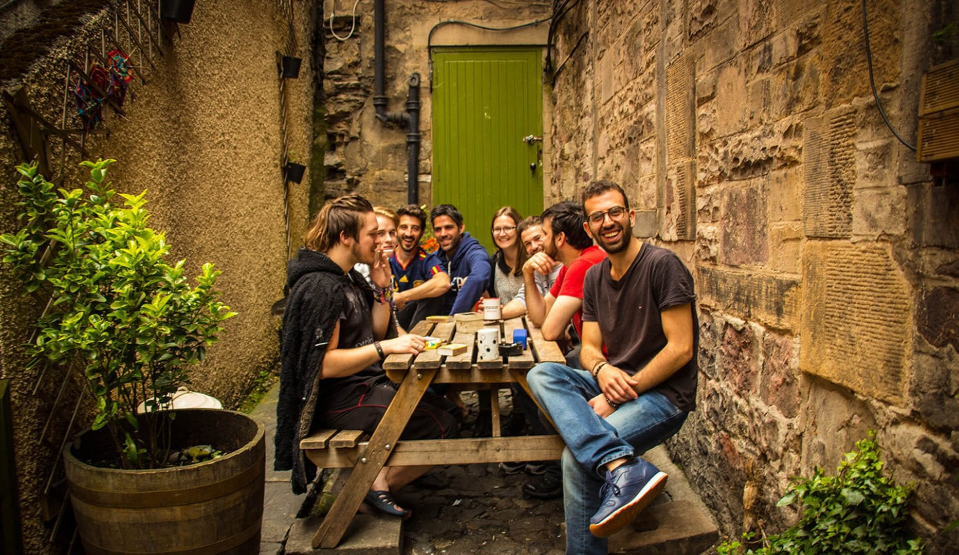 traverllers in the garden at high street hostel in edinbugh