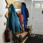 coats and hats at earby hostel on the pennine way