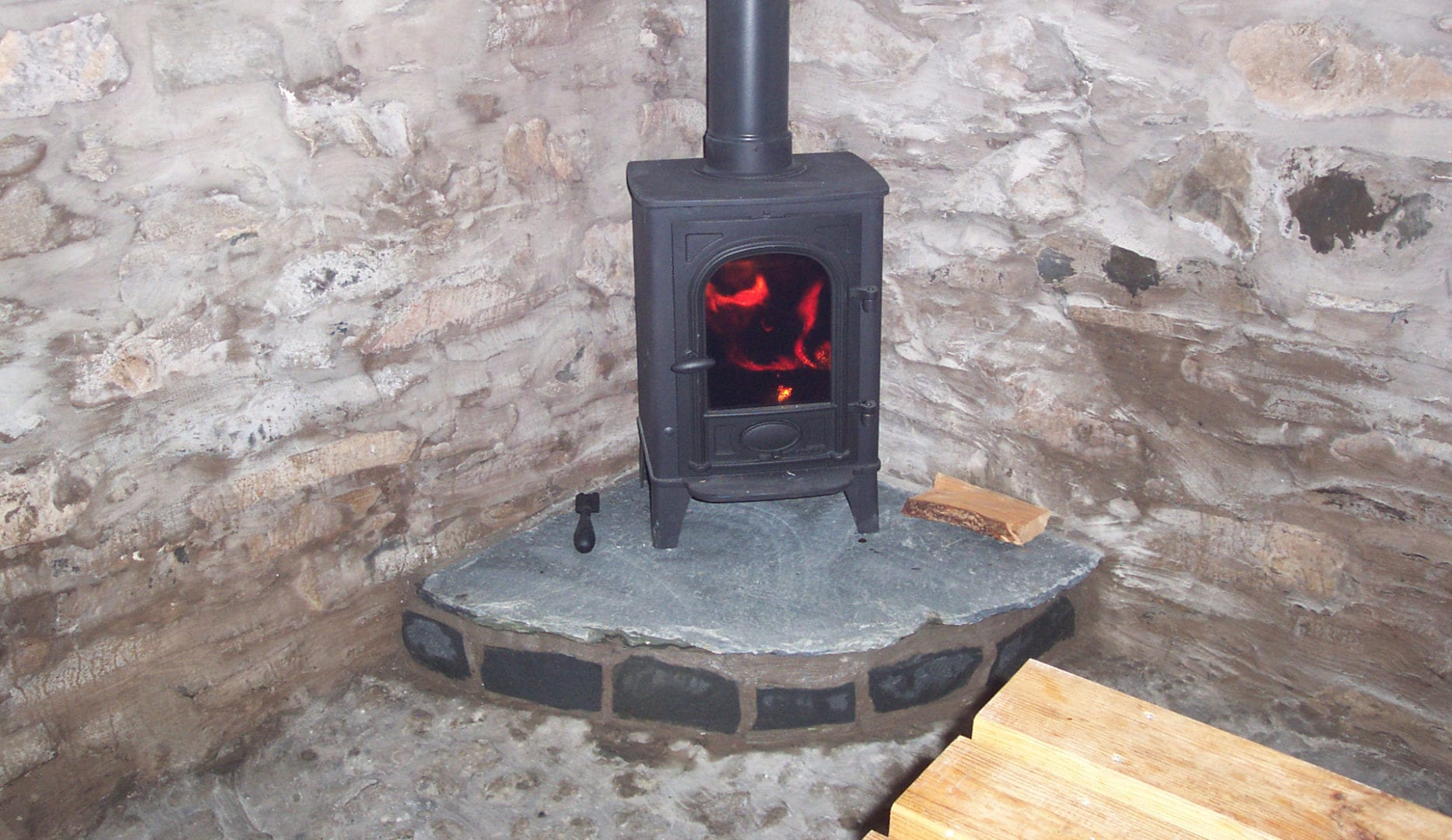 Log burning stove at Fell End Camping Barn