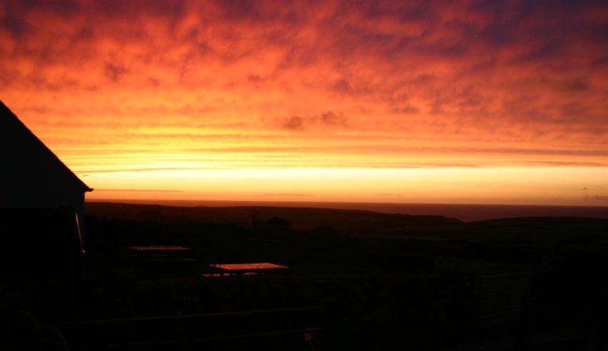sunset over caerhafod lodge on the pembrokeshire coast