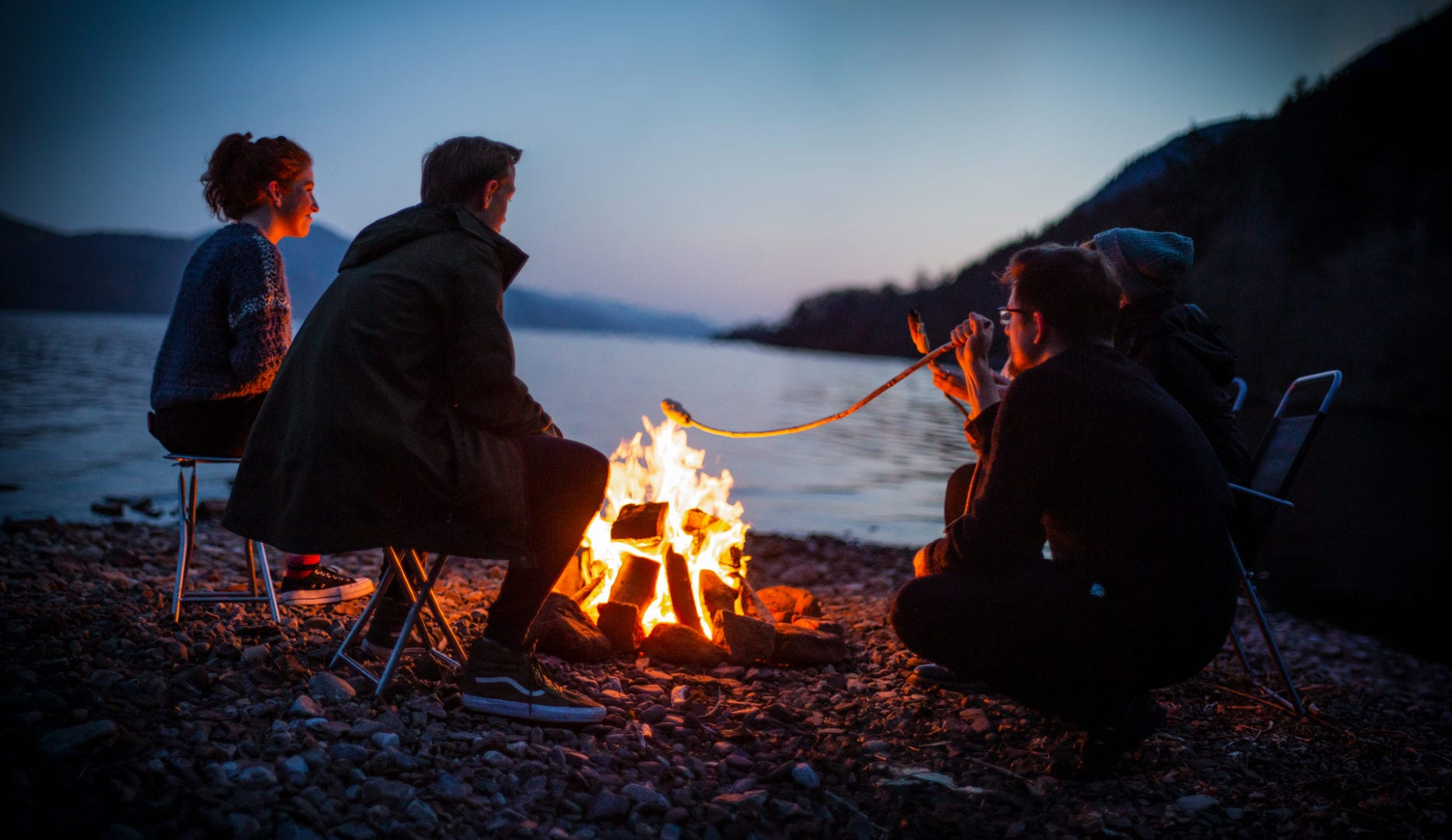 campfire on the banks of lochness by lochside backpackers