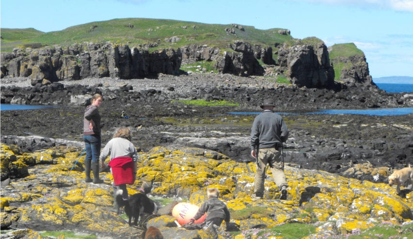 family beach combing on the isle of Muck