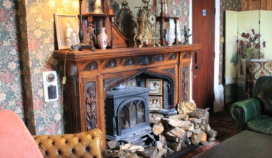 log burner and lounge at craig y nos castle on The Beacons Way