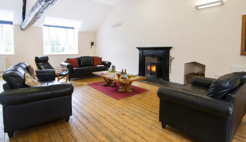 lounge with open fire at Rydal Hall Bunkhouse