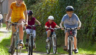 kids on bikes in the countryside