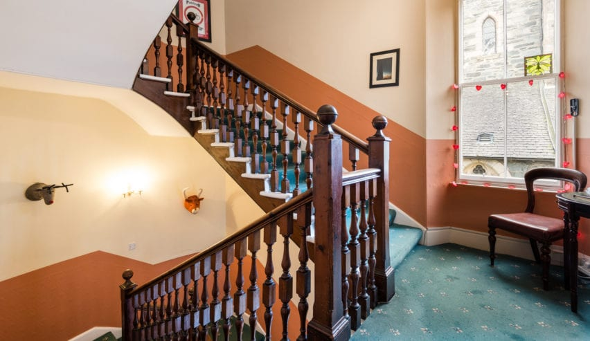 grand staircase at Jessie Macs in Pitlochry