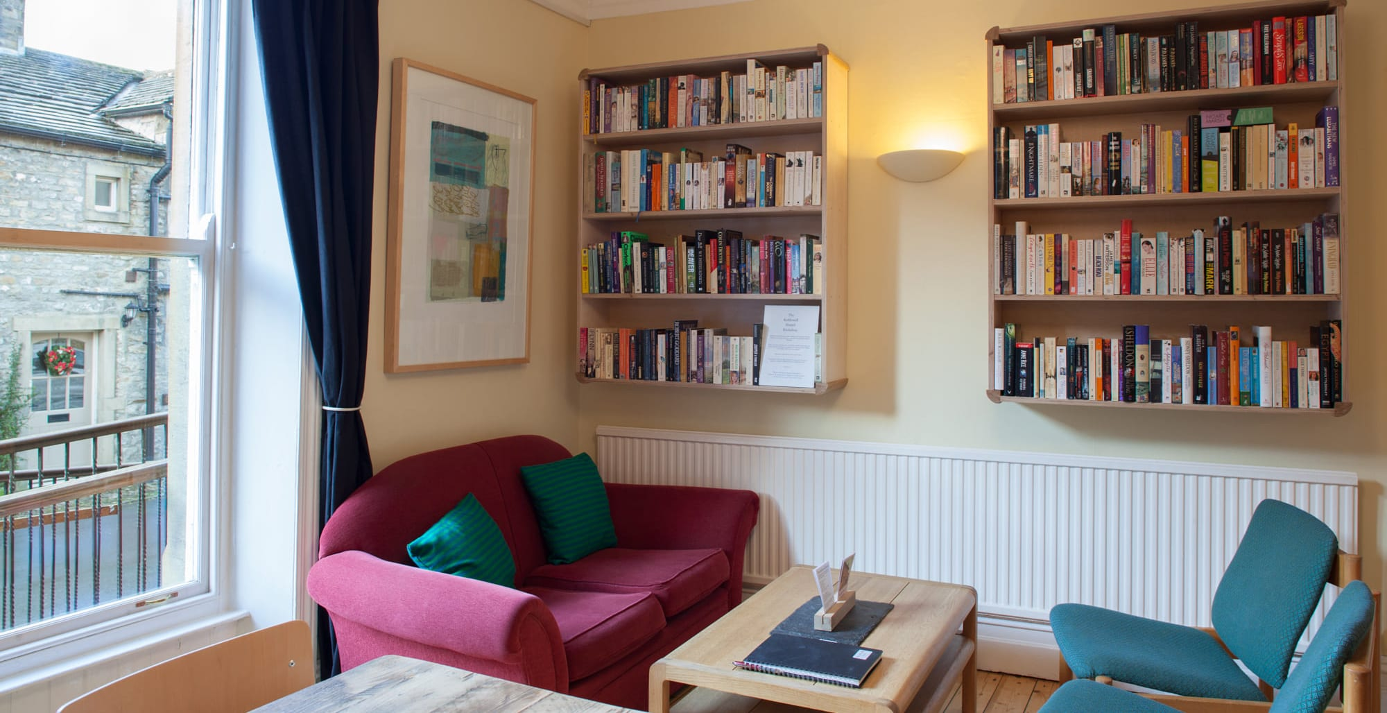 Well stocked bookcases at Kettlewell Hostel
