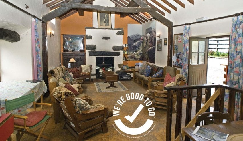 inside of Conwy Valley Backpackers Barn with VisitWales Good to Go certification badge