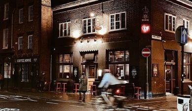 photo at night of cyclist and the rose and crown publove hostel