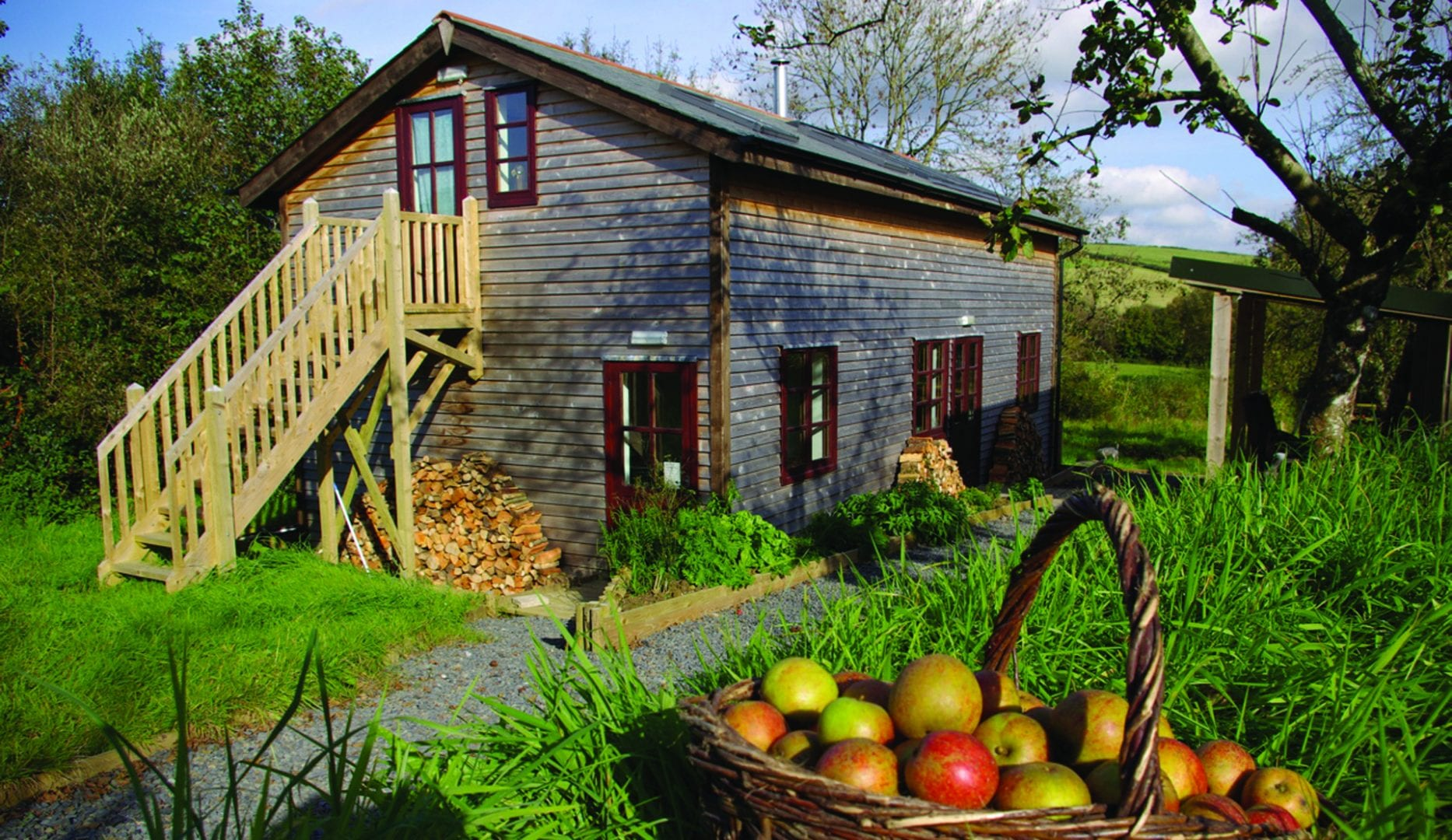 Yarde Orchard Bunkhouse with a basket of apples