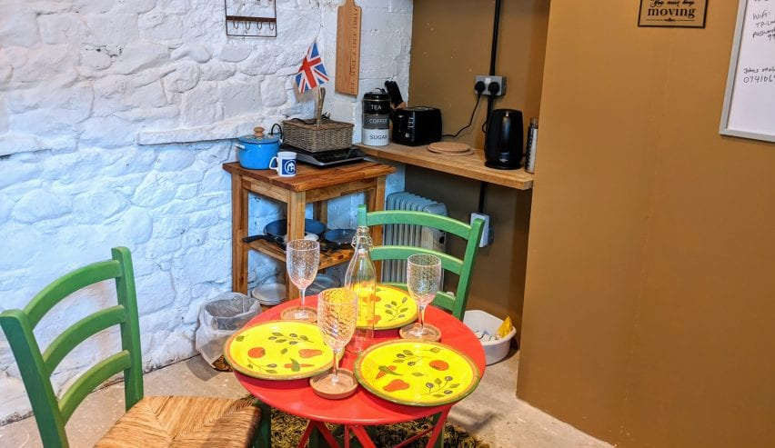 table set for dinner in bothy at Caldbeck Glamping Barns