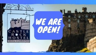 castle rock hostel with open sign