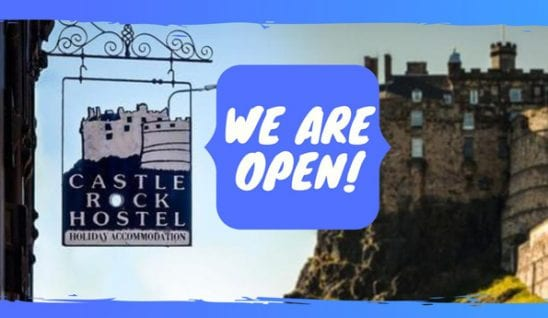 Hostel sign in Edinburgh saying we are open