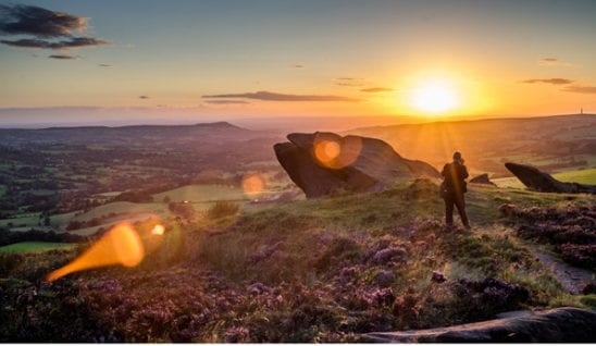man in sunset on an Autumn staycation in the roaches in Peak District