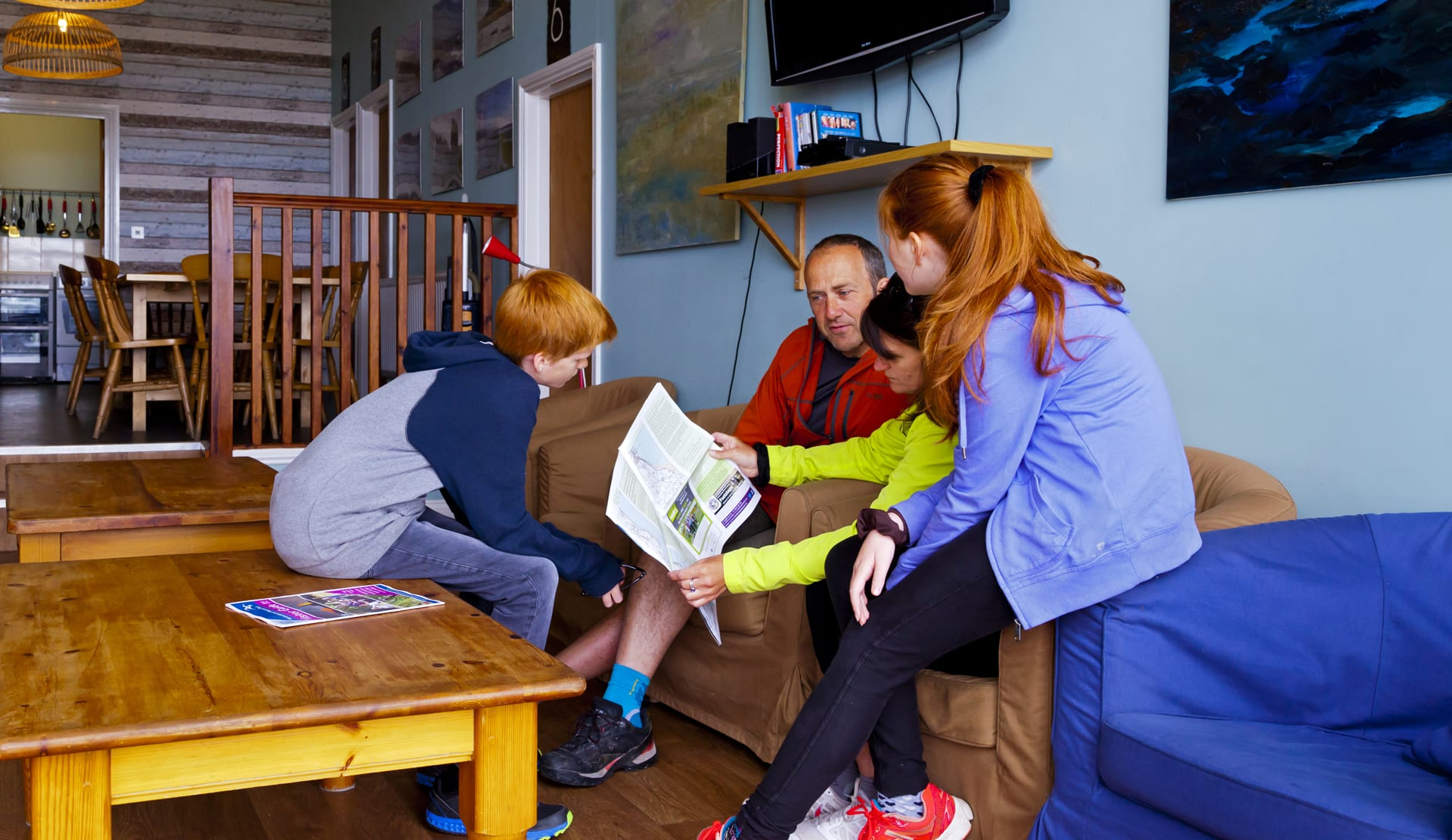 People reviewing map in hostel reopening 2021
