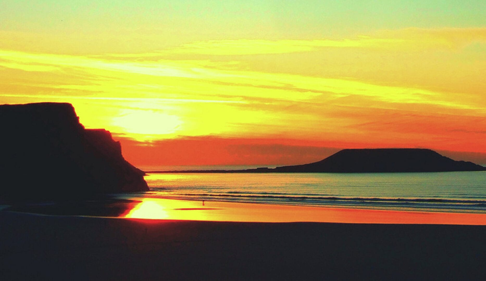 sunset over the seaside from chapel house on the gower