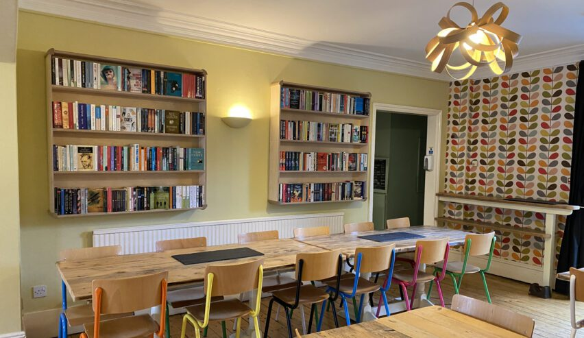 Book lined dining room at Kettlewell Hostel
