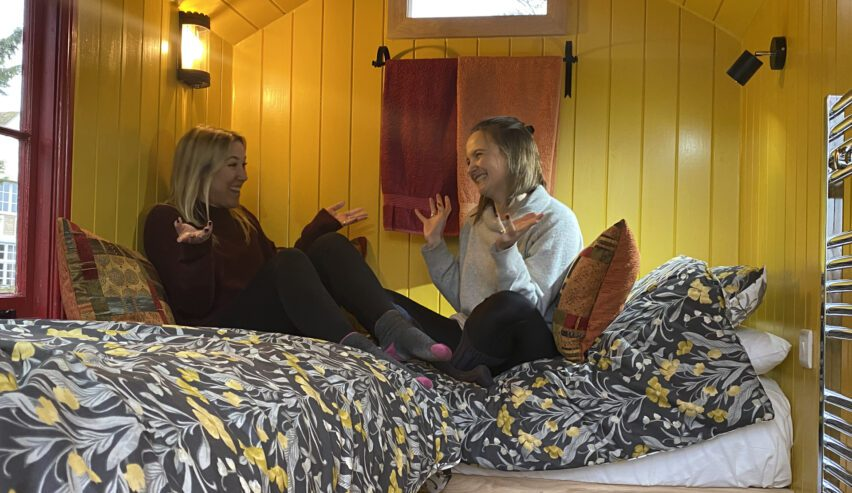 two girls in shepherds hut old brooder bunkhouse self catering in suffolk