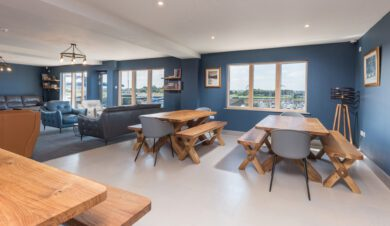 lounge with tables at Radcliffes Lodge Boutique hostel on the Northumberland coast